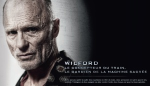 Ed Harris plays Mr. Wilford, the engineer and inventor of the train.