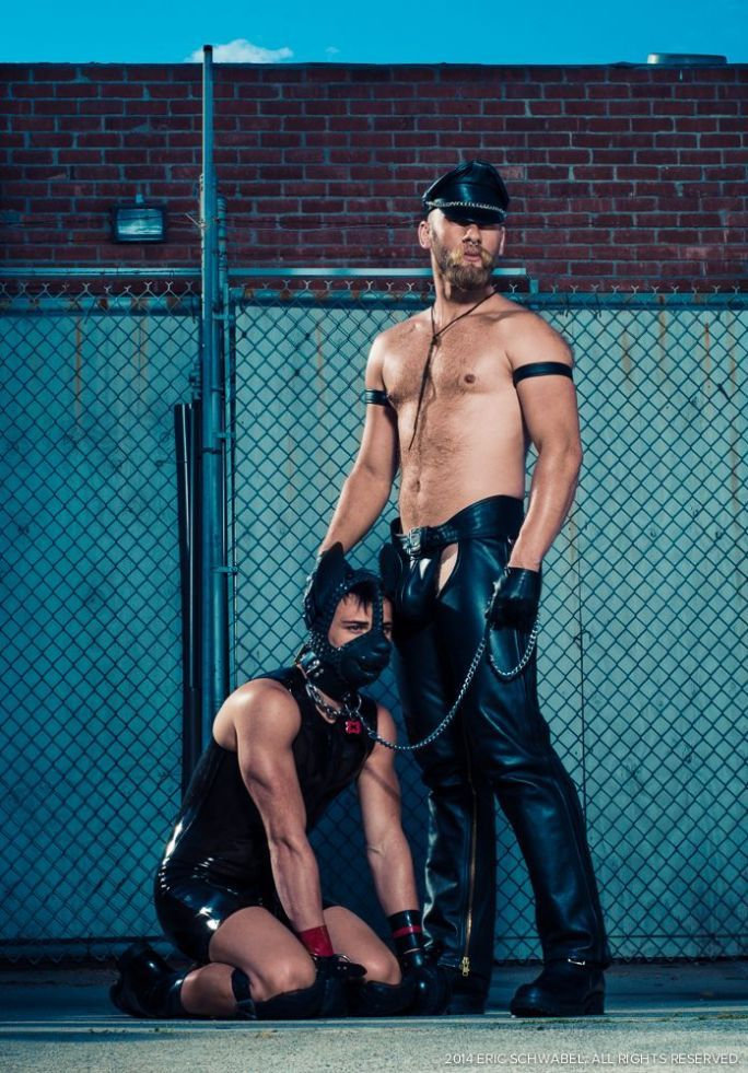 One hot handler is Eric Paul Leue (standing), Mr LA Leather 2014.